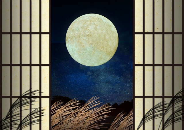 An autumn moon over grasses in Japan.