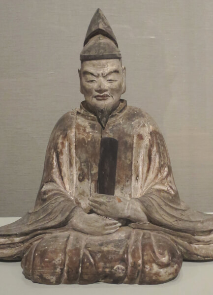 A statue of Sugaware-no-Michizane.
