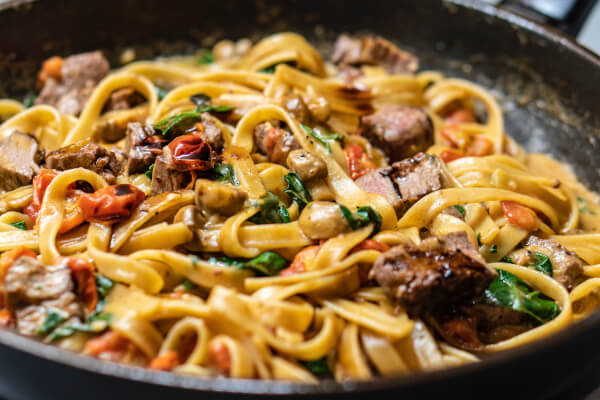 A pasta dish by amirali mirhashemian on unsplash.